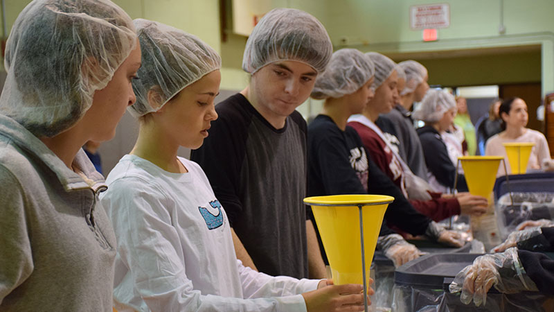 Bellmore-Merrick's One Voice, One Message Initiative Packages 20,000 Meals for the Hungry Photo